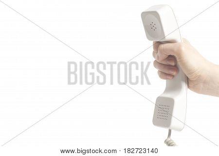 Hand holding white telephone tube isolated on white