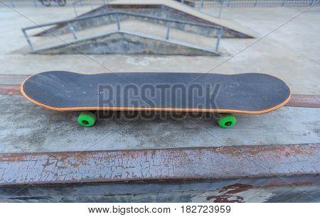 closeup of skateboard at skatepark ramp for riding