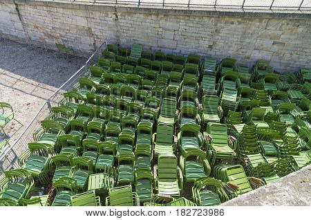 Storage of park furniture - green iron chairs. The Tuileries Garden in Paris France.