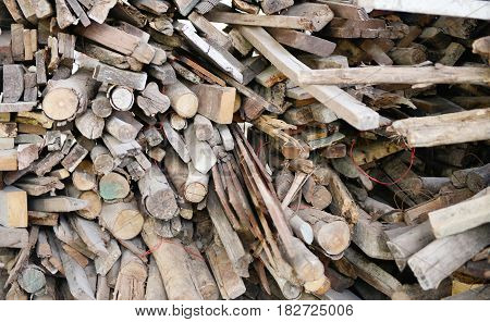 Stacked Wood Logs In Construction Sites, A Pile Of Wooden Logs
