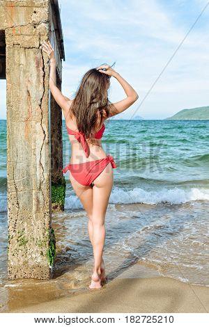 Brunette Woman Standing Near Pier Column