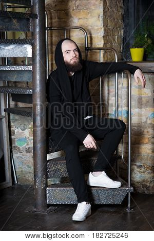 A Bearded Guy On The Stairs.
