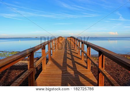 Pier at sunrise located at Crystal Beach Palm Harbor Tampa FLorida USA