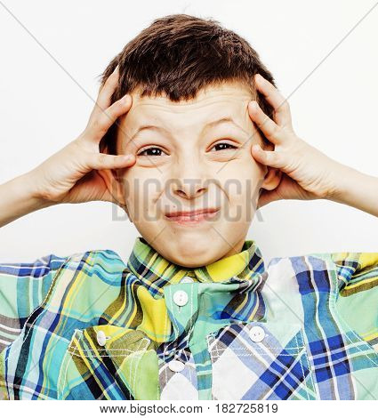young pretty little cute boy kid wondering, posing emotional face isolated on white background, gesture happy smiling close up, lifestyle people concept close up