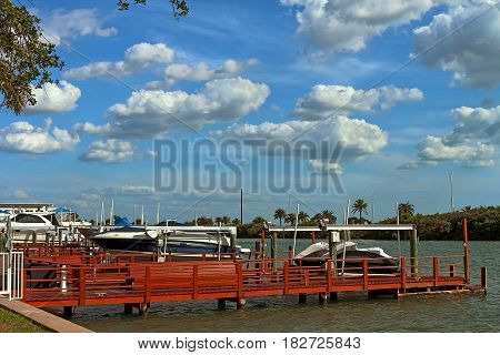 Sports pier with boats and motorboats on a canal in Islad Way Clearwater