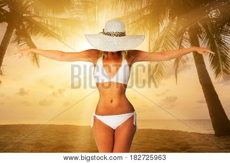 Woman on thetropical  beach at sunset