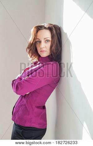 girl in purple white room phone 1