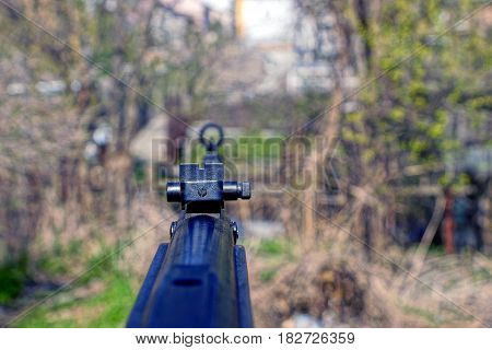 the sight on the part of the air rifle outdoors on a sunny day