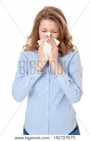 Young woman using tissue. All on white background.