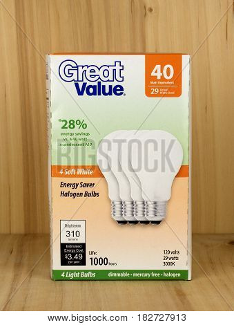 RIVER FALLS,WISCONSIN-APRIL 21,2017: A pack of Great Value brand forty watt light bulbs against a wood background.