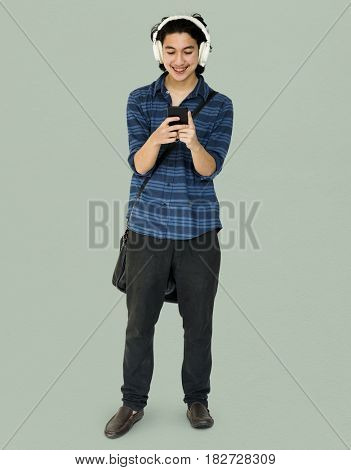 Young man full boady listening music on smart phone