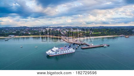 Melbourne Australia - March 26 2017: Passenger and car ferry arriving at Sorrento Pier at dawn on Mornington Peninsula. Aerial panoramic view