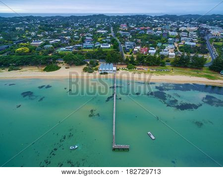 Aerial View Of Sorrento Long Pier, Suburban Houses, And The Baths Restaurant. Mornington Peninsula,