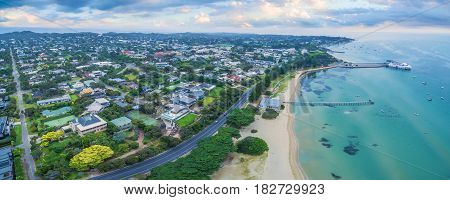Aerial Panoramic View Of Sorrento Long Pier, Moored Passenger Ferry And Point Nepean Road At Dawn.