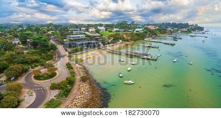 Aerial Panoramic Landscape Of Sorrento Suburb Coastline With Private Piers And Moored Boats. Morning
