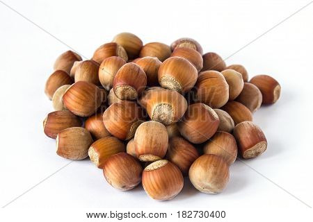 Pile of hazelnuts isolated on white closer, close-up