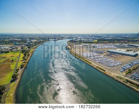 Aerial View Of Yarra River And Large Imported Cars Parking Lots Near Port Melbourne, Victoria, Austr