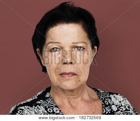 Senior adult woman in moody studio portrait