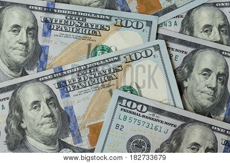 One hundred american dollar banknotes, close-up, top view
