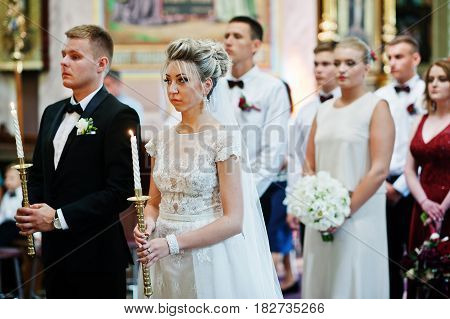 Stylish Wedding Couple With Bridesmaids And Best Mans At Church.