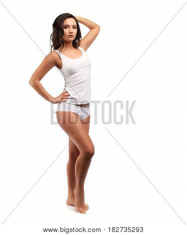 Model Standing In White Cotton Panties And Bra Isolated On White, One Hand On Hip Another Up