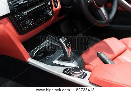 Red luxury car Interior with steering wheel shift lever and air condition and radio button control in car