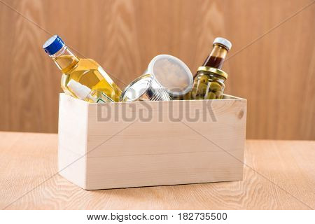 Supportive housing or food donation in box for poor