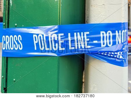 plastic blue police line with do not cross sign