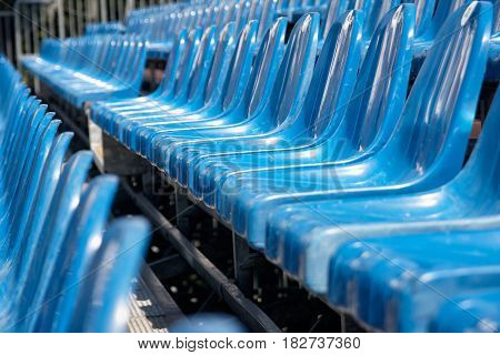 Empty and old plastic seats in the stadium