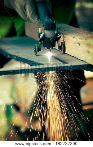 Manual Plasma Cutting metal on plant, cutting