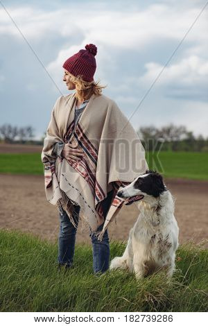 Young woman and dog.