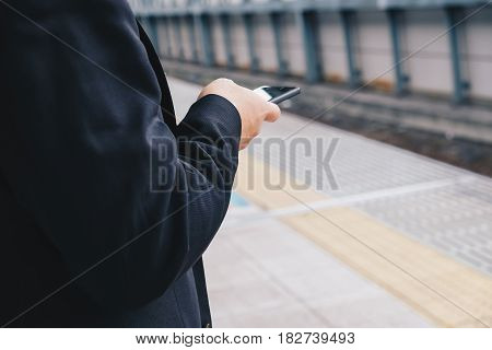 Business Man Use Cellphone At Railway Station