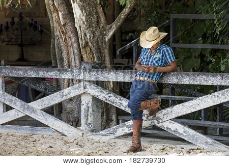 Tulum Mexico March 14th 2017: cowboy with a mobile phone