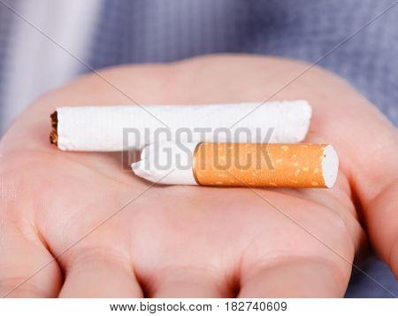 Woman Holding Broken Cigarette, Getting Rid Of Addiction
