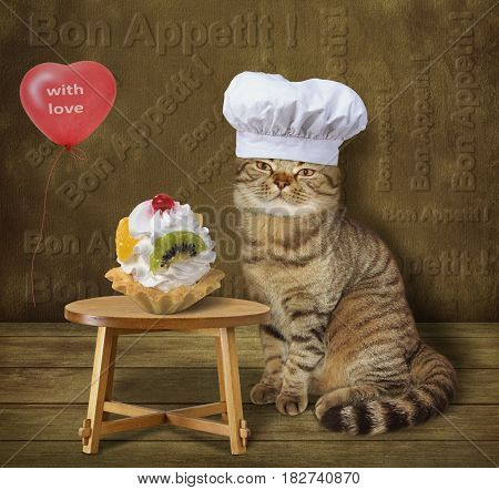 The cat cook made a great dessert. It is on the table. There is a red heart-shaped balloon next to him. He wears a chef hat.