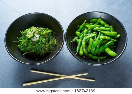 Edamame fresh soya beans soybeans and Algae salad with cucumber Asian starters