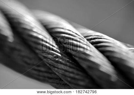 Silver colored metal rope. Power. Macro.Grey. Strong