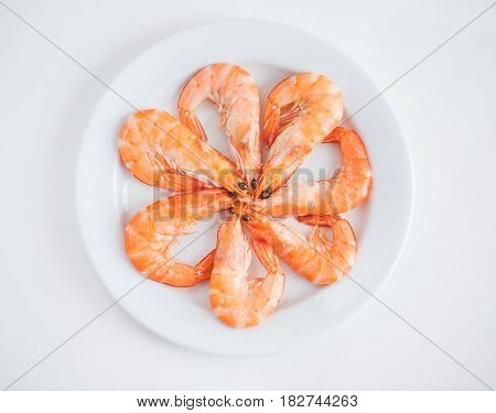 Cooked shrimp in plate isolated on white background