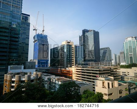 Cityscape of buildings in Phloen Chit Road one of a financial district in Bangkok Thailand.