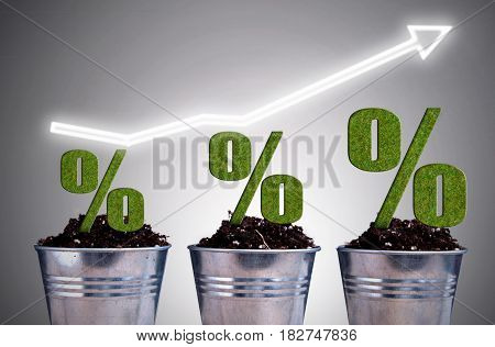 Per cent sign plants at different stages of growth with arrow pointing upwards