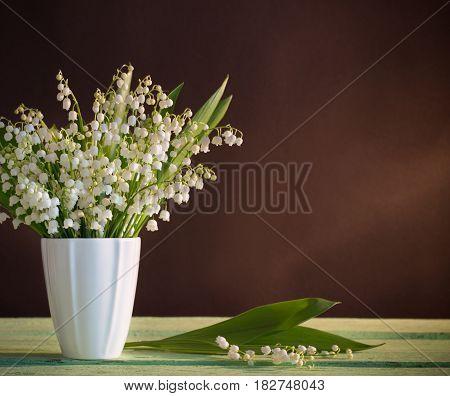Lilly of valley in vase on dark background