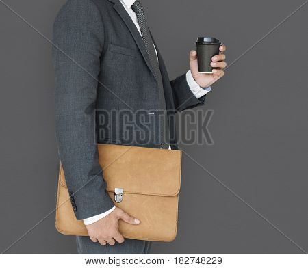Business Man Holding Coffee and Bag