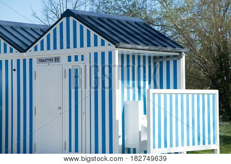 beautiful blue and white cabin that serves as a toilet in the park