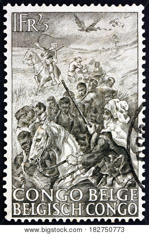BELGIAN CONGO - CIRCA 1947: a stamp printed in Belgian Congo shows Slaves and Arab Guards 50th Anniversary of the Abolition of Slavery in Belgian Congo circa 1947