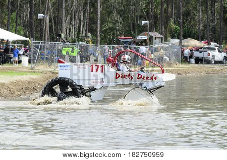 Naples Florida USA - March 3 2012: Swamp buggy eases onto race course