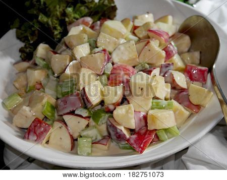 Apple salad A tastefully prepared bowl of apple salad