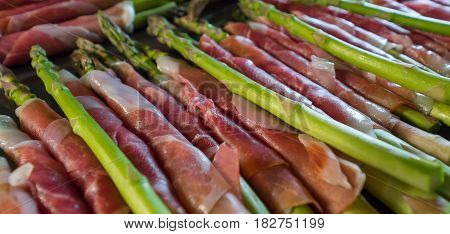 lots of freshly wrapped ham on delicious asparagus