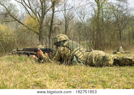 Front Line. Military attack on battlefield with kalashnikov from ambush