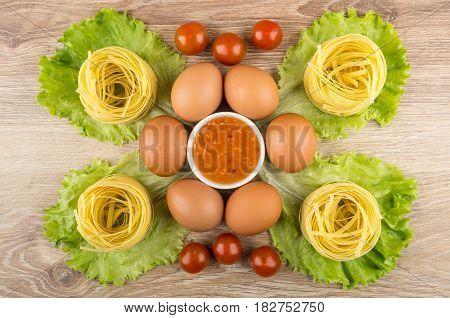 Pasta Tagliatelle, Lettuce, Eggs, Tomato Cherry And Bowl Of Sauce