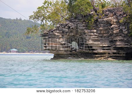 Stone islet, Surigao del Sur, Philippines A beautiful pile of stones in an islet in Cantilan, Surigao del Sur, southern Philippines.